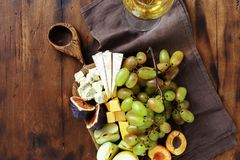 Appetizers table wine Fruit cheese wooden board. Set appetizers table and wine. Fruit and cheese on wooden board. Wine appetizers stock photos