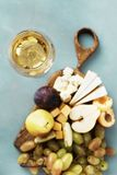 Appetizers table wine Fruit cheese Wine appetizers. Appetizers table and wine. Fruit and cheese on wooden board on stone background. Wine appetizers stock photos