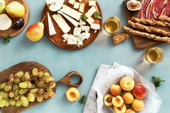 Appetizers table wine Fruit cheese Wine appetizers. Appetizers table and wine. Fruit and cheese on wooden board on stone background. Wine appetizers stock images