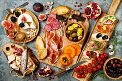 Free Appetizers Table With Italian Antipasti Snacks. Brushetta Or Authentic Traditional Spanish Tapas Set, Cheese Variety Board Royalty Free Stock Images - 106327129