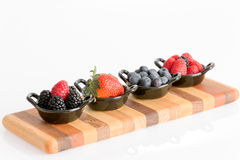 Appetizers of tasty fresh autumn berries royalty free stock images