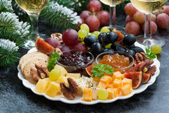 Appetizers to the holiday - cheeses, fruits and jams Stock Images