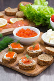 Appetizers - toast with salted salmon and red caviar Royalty Free Stock Photography