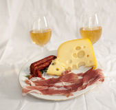 Appetizers with white wine stock photos