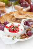 Appetizers for wine - camembert with berry jam, toast and fruit Royalty Free Stock Image