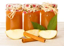 Appetizing Apple Jams. With cinnamon in glass jars Royalty Free Stock Image
