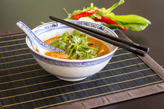 Appetizing Asian Food on White Bowl on Table Stock Photo
