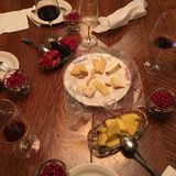 Appetizing Assortment of Fresh Cut Up Fruit and Gourmet Cheeses Plate and Wine - Smorgasbord Dining Table Setting High-Angle View. Appetizing Assortment of Stock Images