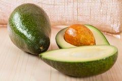 Appetizing avocado on wooden table Stock Photos