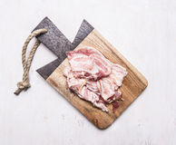 Appetizing bacon on a cutting board wooden rustic background top view close up Royalty Free Stock Images