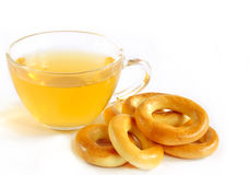 Appetizing bagels and cup of green tea Royalty Free Stock Photography