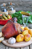 Appetizing Bavarian roast pork knuckle on cutting board Stock Images
