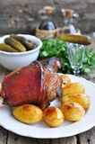 Appetizing Bavarian roast pork knuckle on cutting board Stock Photography