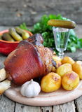 Appetizing Bavarian roast pork knuckle on cutting board Royalty Free Stock Images