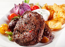 Appetizing Beef Steak with Potato Wedges and Dip Stock Image