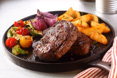 Appetizing Beef Steak with Veggies on Skillet Stock Image