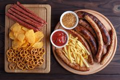 Appetizing beer snacks set for big company of friends. Grilled s royalty free stock images