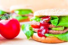 Appetizing big cheeseburger fresh lettuce cucumber Royalty Free Stock Image