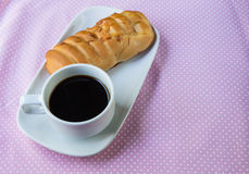 Appetizing bread and cup of coffee Royalty Free Stock Photo