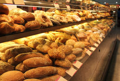 Appetizing bread on showcase. Different appetizing bread on showcase in supermarket Stock Photo
