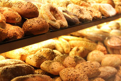 Appetizing bread on showcase. Different appetizing bread on showcase in supermarket Stock Photos