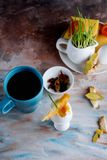 Appetizing breakfast of boiled eggs and strong aromatic tea on t. Delicious breakfast from a boiled egg and brewed tea on a background royalty free stock photo