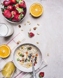 Appetizing breakfast with fresh strawberries, oatmeal, orange juice border ,place for text on wooden rustic background top view cl. Appetizing breakfast fresh stock photography