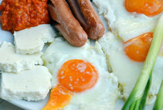 Appetizing breakfast with fried sausages. Pic of a Appetizing breakfast ffried sausages royalty free stock photography