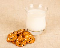 Appetizing Breakfast. Tasty diet for the mornings - a glass of milk and salty biscuits royalty free stock photo