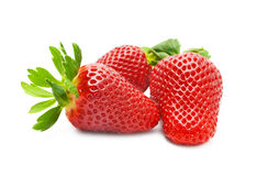 Appetizing brightly red strawberry on a white background. Ripe strawberries on a white background Stock Photos