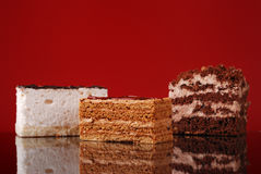 Appetizing cakes on dark red background Royalty Free Stock Image