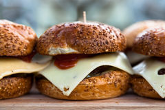 Appetizing cheeseburgers. Some of appetizing cheeseburgers on a wooden board Stock Photo