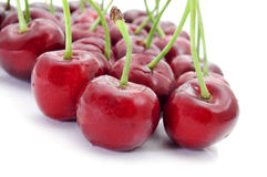 Appetizing cherries. Closeup of some appetizing cherries on a white background Stock Photo