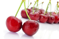 Appetizing cherries. Closeup of some appetizing cherries on a white background Stock Images