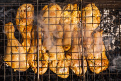 Appetizing chicken legs on the grill. Royalty Free Stock Photography