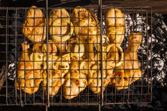 Appetizing chicken legs on the grill. Royalty Free Stock Photo