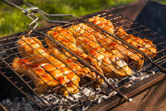 Appetizing chicken legs on the grill. Stock Photo