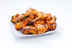 Appetizing chicken legs on grill with golden crust Stock Photography