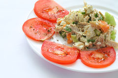 Appetizing chicken salad decorated with tomatoes. Isolated on white plate Royalty Free Stock Images