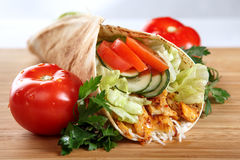 An appetizing chicken wrap with cucumbers. And tomatoes royalty free stock photos