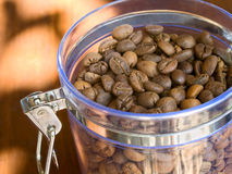 Appetizing coffee beans in glass container. Royalty Free Stock Photography