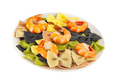 Appetizing colored farfalle pasta with chrimp Stock Images
