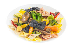 Appetizing colored farfalle pasta with vegetables Stock Image