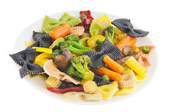 Appetizing colored farfalle pasta with vegetables Stock Photography