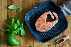 Delicious salmon steak in the pan. royalty free stock photos