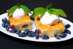 Appetizing cottage cheese casserole with berries and sour cream Stock Photography