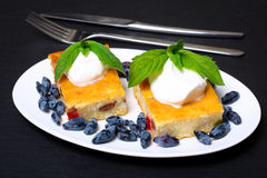 Appetizing cottage cheese casserole with berries and sour cream Royalty Free Stock Image