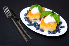 Appetizing cottage cheese casserole with berries and sour cream Stock Image