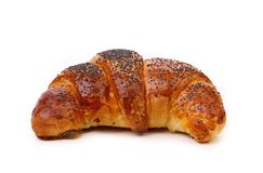 Appetizing croissant with poppy. Stock Images
