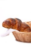 Appetizing croissants with poppy in basket. Royalty Free Stock Images